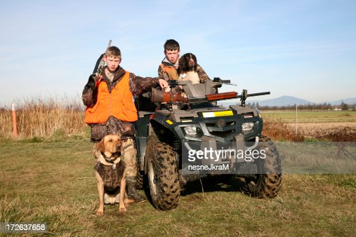 Two hunters and their dogs