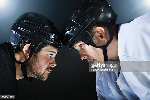 Two ice hockey players facing off.