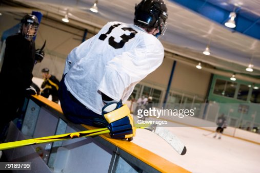 Two ice hockey players watching ice hockey : Stock Photo
