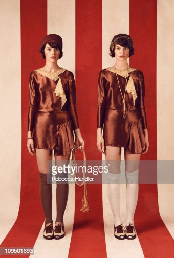 Two identical women wearing 1920s clothing : Stock Photo