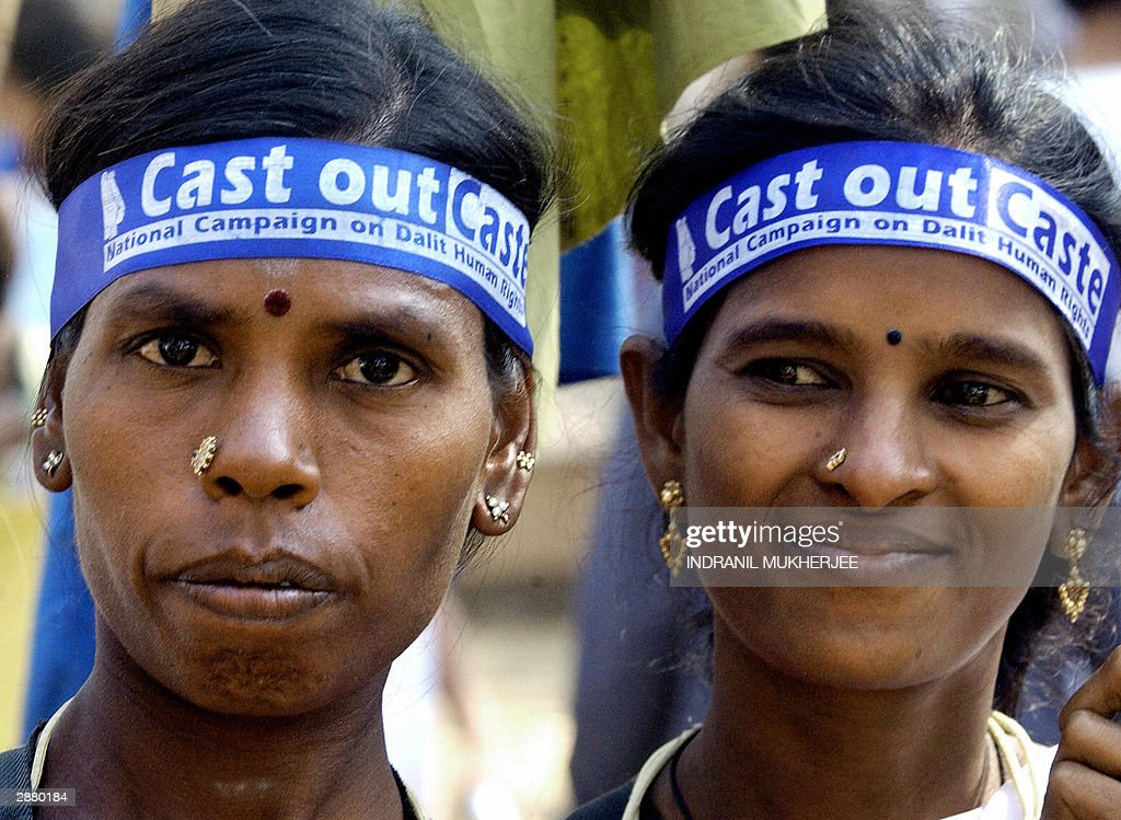 Two Indian female Dalits, members of Hinduism lowest caste, march at the 2004 World Social Forum (WSF) in Bombay, 19 January 2004. Anti-globalisation activists demanded the world economic system to better represent the poor as the WSF dedicated the day to highlighting the plight of low-caste Hindus in host country India. AFP PHOTO/Indranil MUKHERJEE