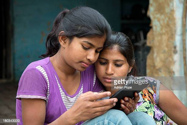 Two Indian girls using tablet device