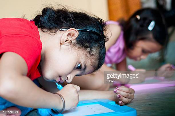 Two Indian Girls writing