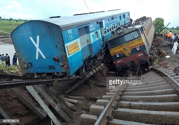 Two Indian passenger trains lay next to each other following a derailment after they were hit by flash floods on a bridge outside the town of Harda...