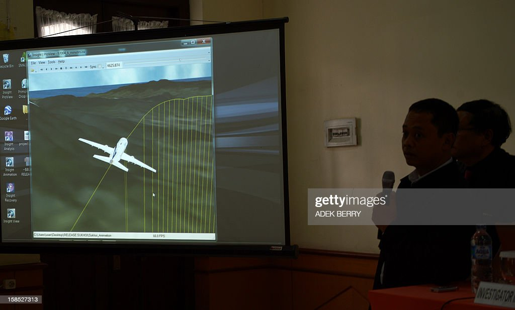 Two Indonesian investigators explain to journalists reasons for the deadly May crash of the Russian Sukhoi Superjet 100 during a press conference in...