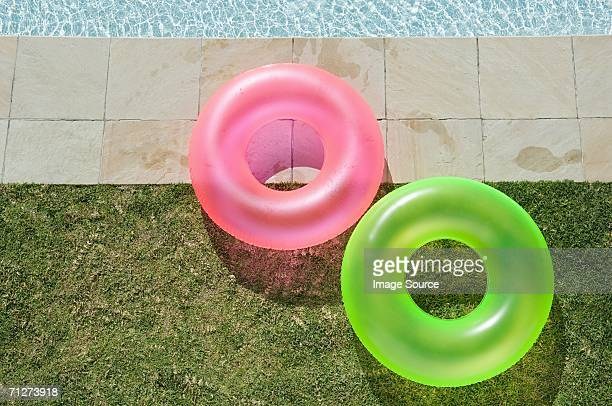 Two inflatable rings by the pool
