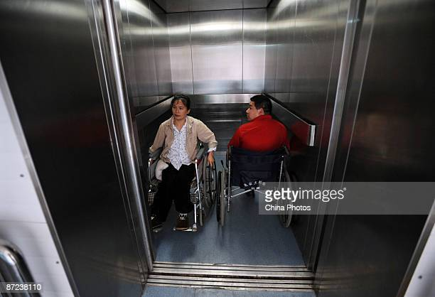 Two injured earthquake survivors take an elevator at the earthquake rehabilitation center of the Sichuan Provincial People's Hospital on May 14 2009...