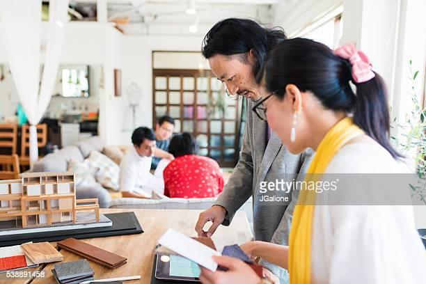 Two interior designers discussing sample materials