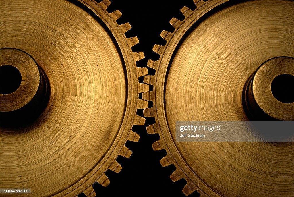 Two interlocked brass gears, close-up