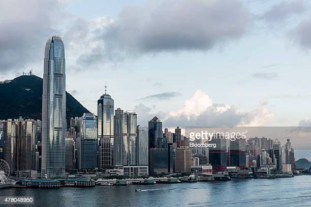 Two International Finance Centre front second left and other commercial and residential buildings standing on Hong Kong island are seen from the Tsim...