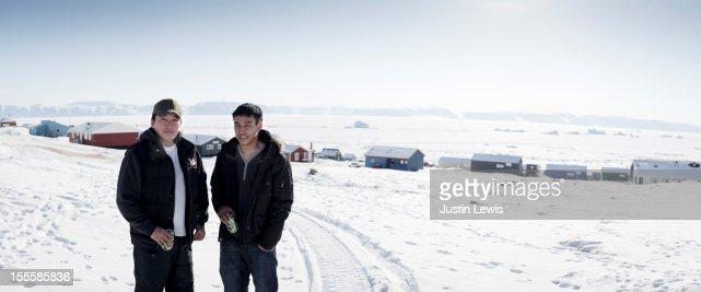 Two Inuit males in front of town-Qaanaaq Greenland : Bildbanksbilder