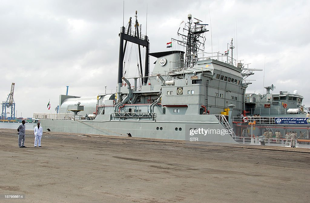 Two Iranian warships dock in the Sudanese Red Sea city of Port Sudan on December 8, 2012. The Iranian navy said the 1,400 ton frigate Jamaran and the 4,700 ton support ship Bushehr 'docked in Port Sudan, after successfully carrying out their assignments in the Red Sea and were greeted by high-ranking Sudanese naval commanders.' Khartoum said it was a 'normal' port call but Israeli officials have expressed concern about arms smuggling through Sudan. AFP PHOTO/STR