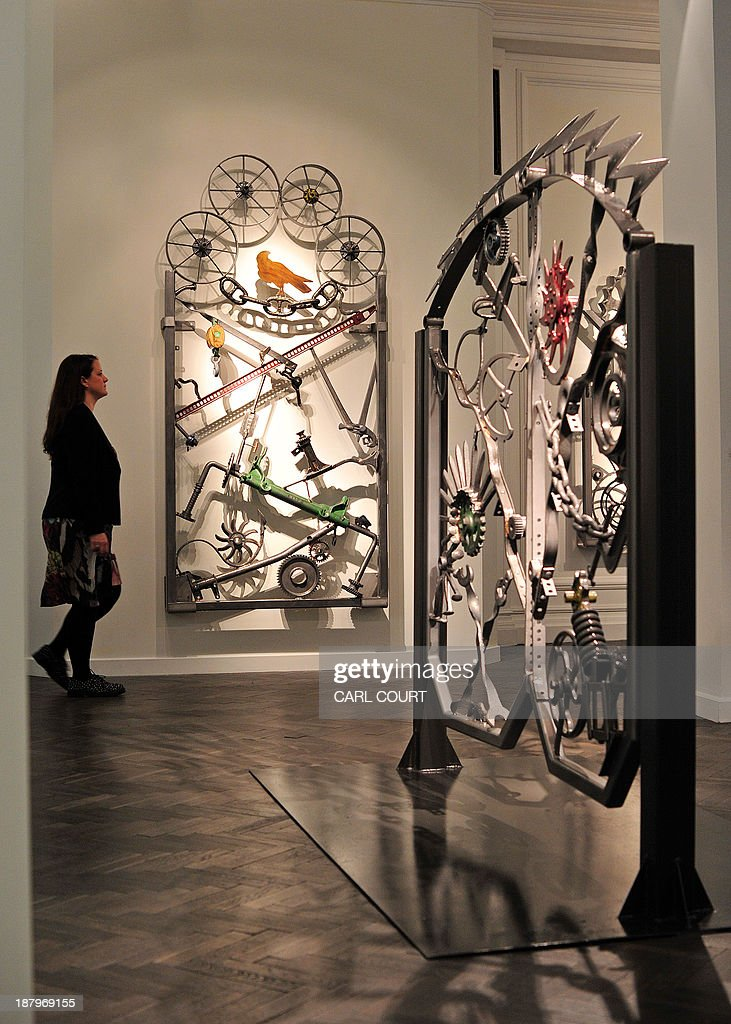 Two iron gate artworks, called 'Untitled VI' (R) and 'Untitled I,' designed by US musician Bob Dylan, are pictured during a photocall for an exhibition entitled 'Bob Dylan: Mood Swings' at the Halcyon Gallery in central London, on November 14, 2013. The exhibition, which runs until January 25, 2014, features Dylan's artworks and includes iron sculptures, paintings and bullet-ridden car doors. AFP PHOTO/CARL COURT