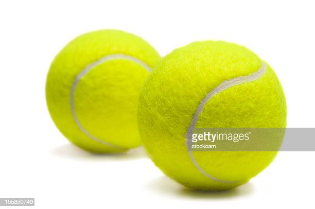 Two isolated yellow tennis balls