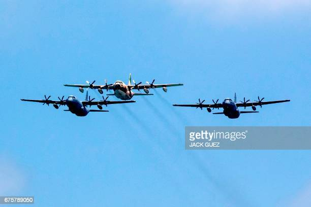 Two Israeli cargos Samson C130J Super Hercules and one C130 Hercules perform during an air show over the beach in the Israeli coastal city of Tel...