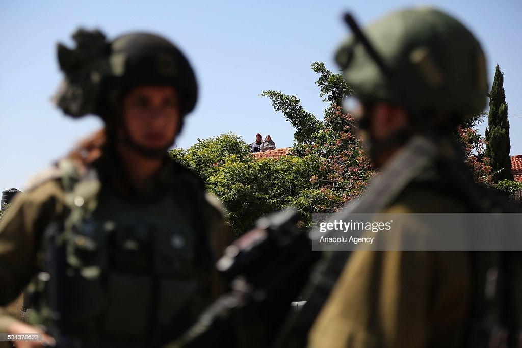 Two Israeli security guards are seen as Israeli security forces increase the security measures around Hizma district of Jerusalem on May 26, 2016.