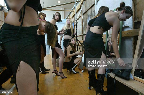 Two Israeli teenagers get ready moments before a rehearsal for a beauty contest to choose 'Miss Shomron' in the Jewish settlement of Ariel in the...