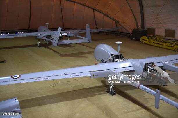 Two Israeli's Harfang drones bought by the French military and used for Operation Barkhane an antiterrorist operation in the Sahel sits in a hanger...