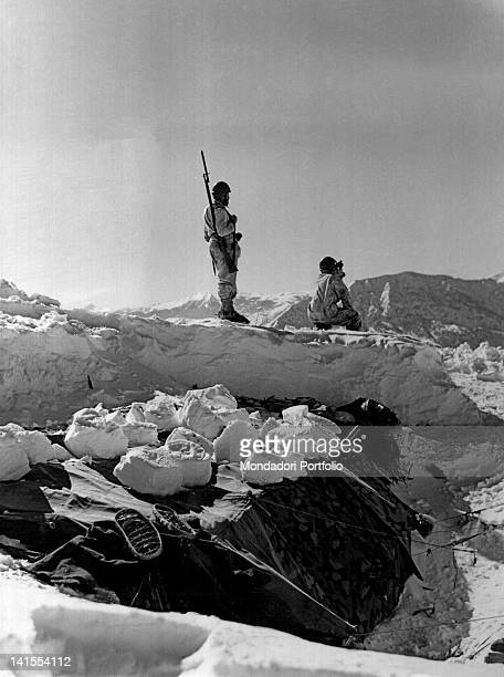 Two Italian Alpine soldiers on the lookout on a snowy peak of Tomorizza Valley Greece February 1941