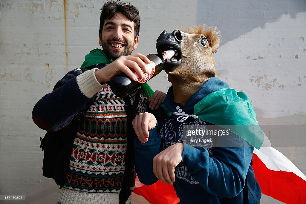 Two Italian rugby fans pose for a photograph prior to the international match between Italy and Australia at the Stadio Olimpico on November 9, 2013 in Turin, Italy.