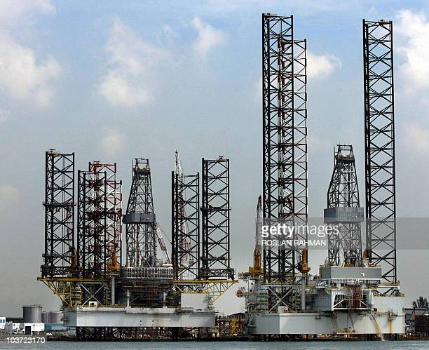 Two jackup rigs stand at shipyard in Singapore 12 April 2006 Singapore's oil rig manufacturers have received orders totalling more than two billion...