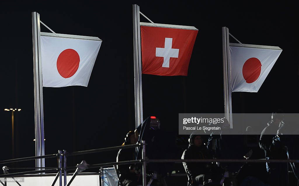 Two Japanese and a Swiss flag are raised for silver medalist Ayumu Hirano of Japan, gold medalist Iouri Podladtchikov of Switzerland and bronze medalist Taku Hiraoka of Japan during the medal ceremony for Snowboard Men's Halfpipe on day five of the Sochi 2014 Winter Olympics at Medals Plaza on February 12, 2014 in Sochi, Russia.