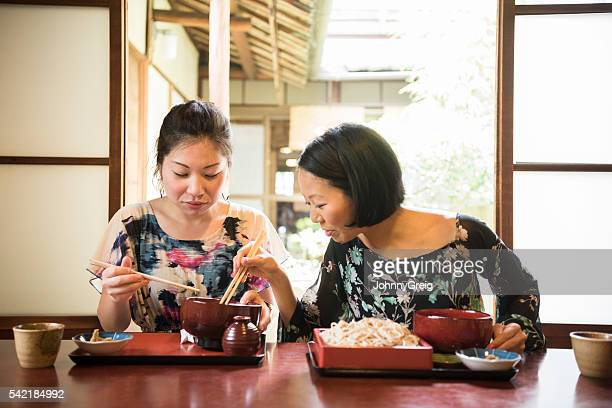 Two Japanese woman in restaurant with dinner
