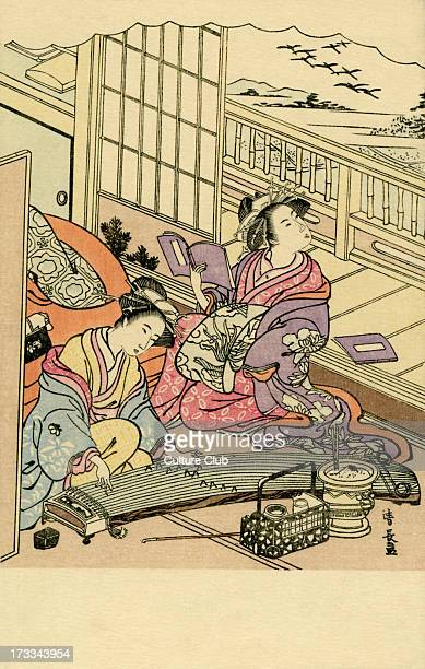 Two Japanese women at court one plays music the other reads Shimbi Shoin Tokyo was known from 18991938 for reproducing such images for commercial...