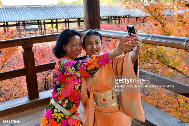 Two Japanese Women Taking Selfie at Tofuku-ji Temple, Kyoto