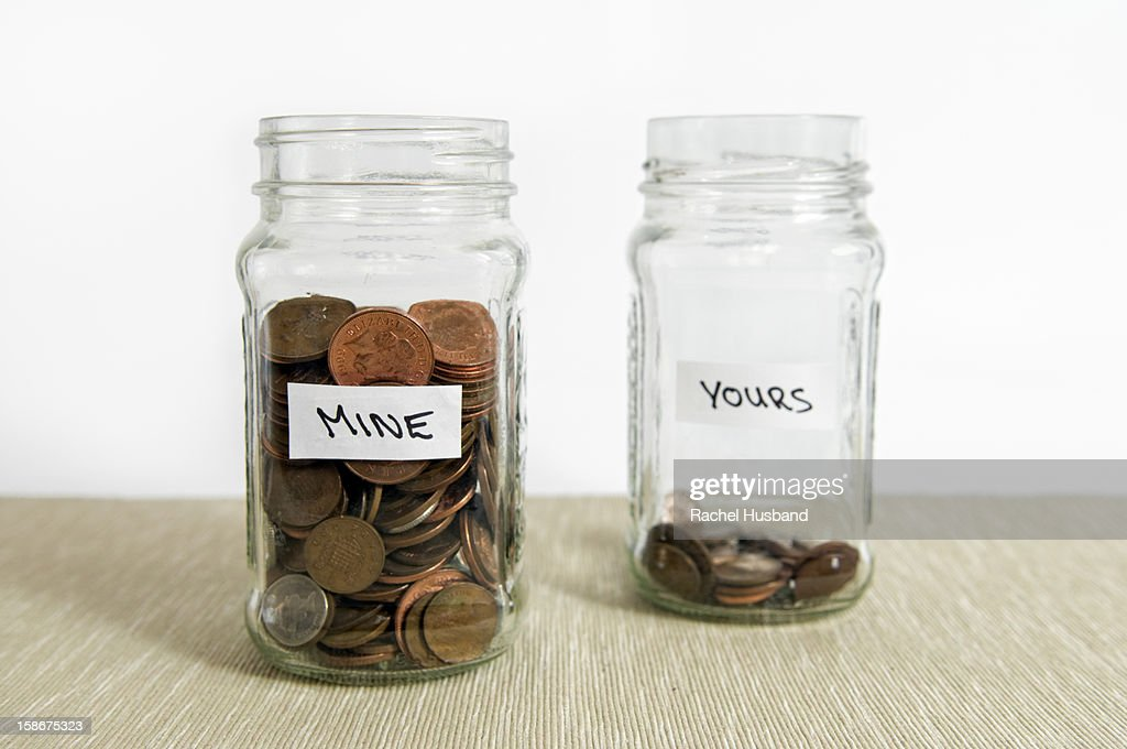 Two jars with loose change in sterling currency : Stock Photo