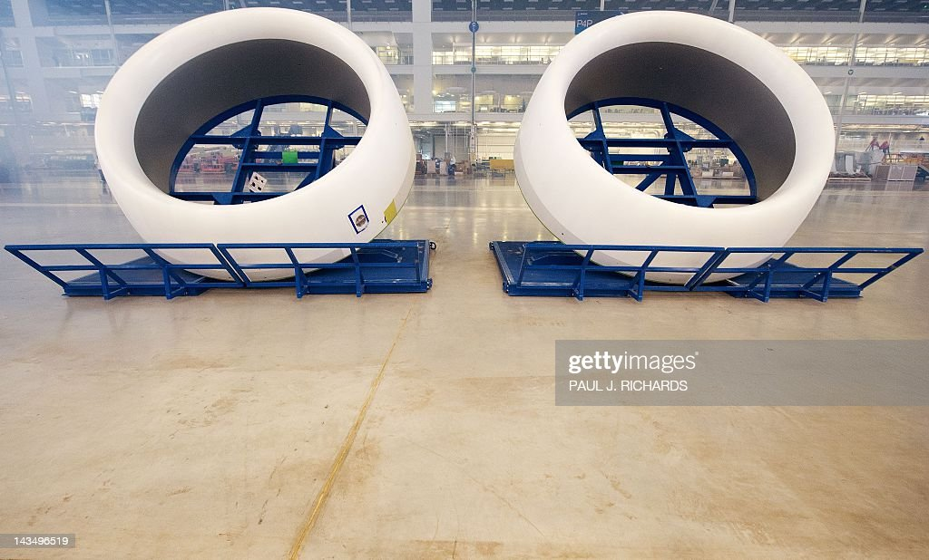Two jet engine cowlings wait to be attached on a new Boeing 787 Dreamliner on the production floor at Boeing's new facilities April 27, 2012, in North Charlston, South Carolina. Boeing rolled-off it's first South Carolina made 787 Dreamliner aircraft here today. AFP PHOTO/Paul J. Richards / AFP / PAUL