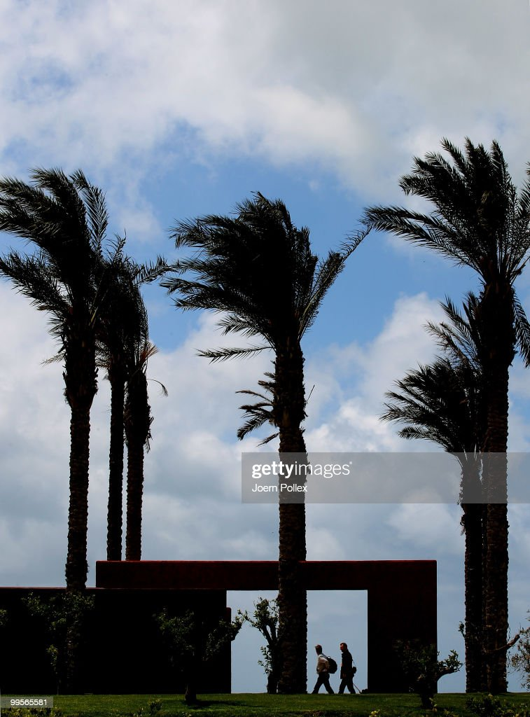 Two journalists on their way to the press conference are pictured at Verdura Golf and Spa Resort where the Geman National Football Team stays for training on May 15, 2010 in Sciacca, Italy.