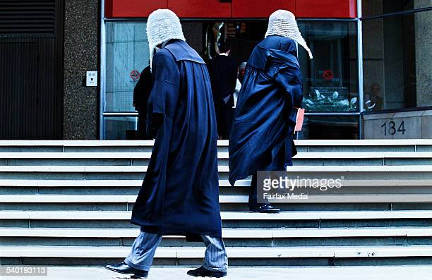 Two judges on the steps of the supreme court in sydney