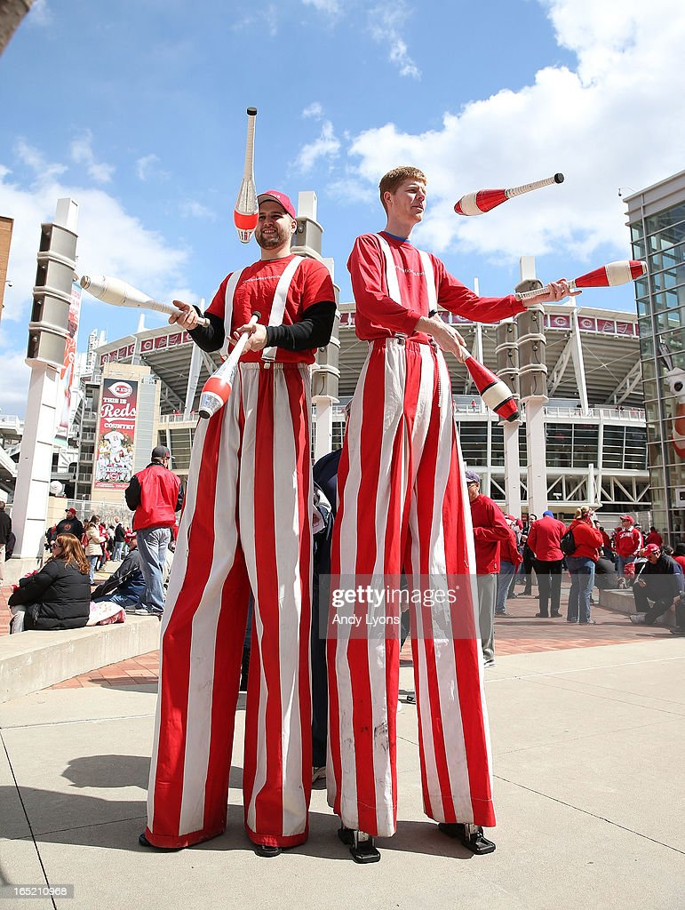 Two jugglers perform before the start of the Los Angeles Angels of Anaheim game against the Cincinnati Reds at Great American Ball Park on April 1, 2013 in Cincinnati, Ohio.