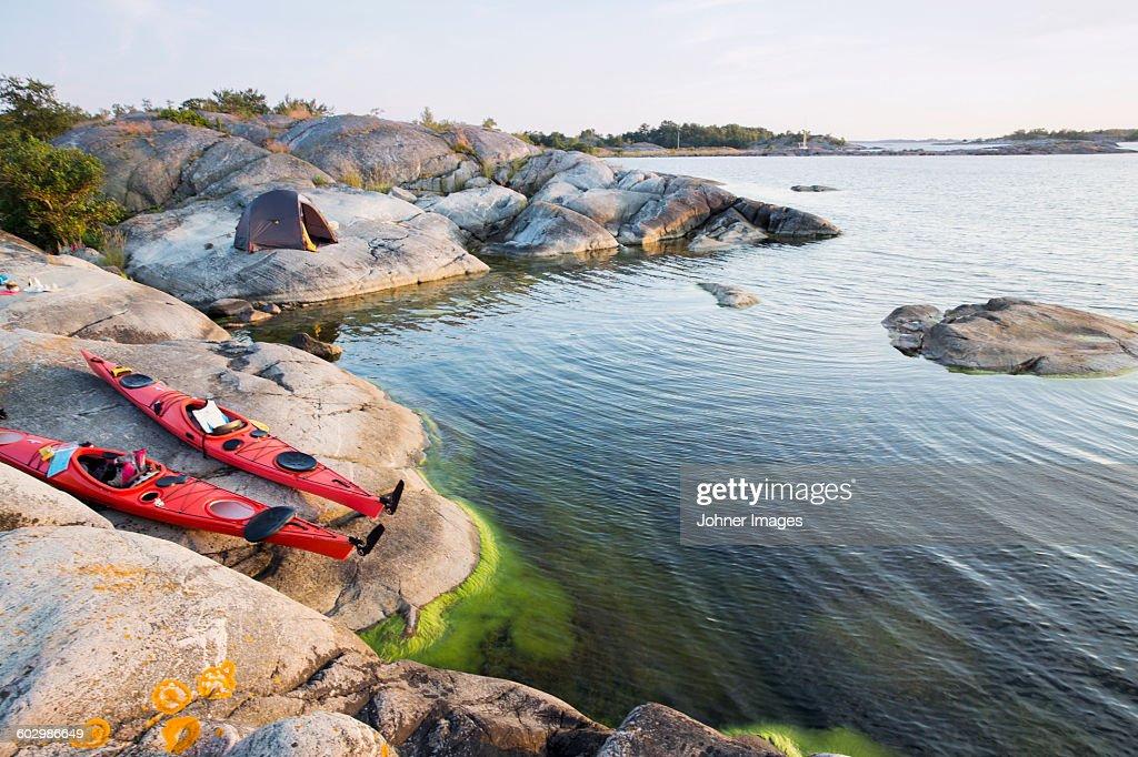 Two kayaks on lakeshore
