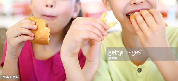 Two kids eating.