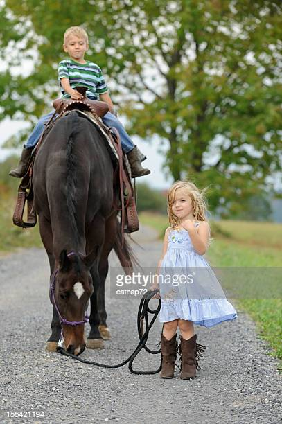 Two Kids with Big Horse  on Summer Country Lane