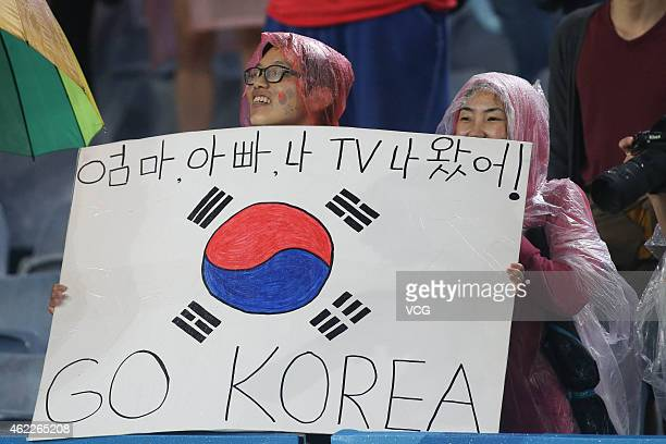 Two Korean fans show a placard during the Asian Cup Semi Final match between Korea Republic and Iraq at ANZ Stadium on January 26 2015 in Sydney...
