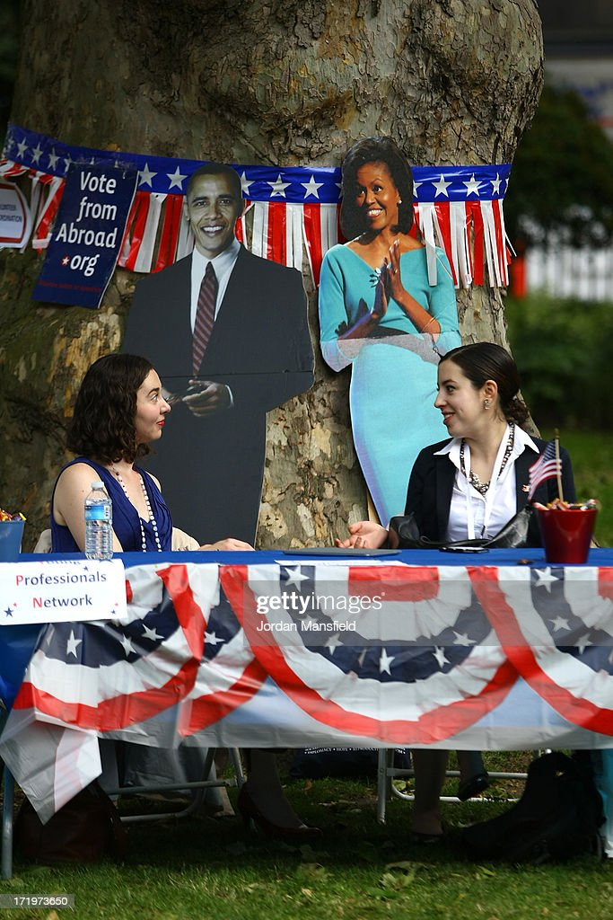 Two ladies give advice to Americans who live in London on how to vote in the US elections on June 30, 2013 in London, England. American Democrats living in London gather in Portman Square for the largest Independence Day celebration in London ahead of the American federal holiday on the 4th July which commemorates the Declaration of Independence on July 4, 1776 which declared them the USA free from the Kingdom of Great Britain.