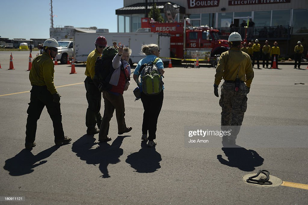 Two ladies leaving with rescue personal after they were hoisted into a UH-60 Black Hawk near Jamestown during search and rescue flight with members of the 2-4 GSAB with the 4th ID of Fort Carson September 17, 2013 Boulder, CO.