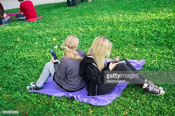 Two ladies Pokemon gaming in Ljubljana park, Slovenia