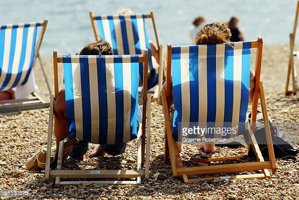 Two ladies relax enjoying the sunshine on Brighton beach July 30 2004 in Brighton England The United Kingdom is set for soaring temperatures this...