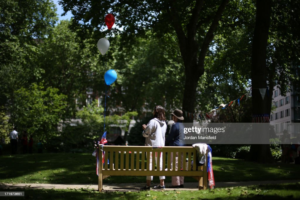 Two ladies stand by a bench with American flag bunting and balloons on June 30, 2013 in London, England. American Democrats living in London gather in Portman Square for the largest Independence Day celebration in London ahead of the American federal holiday on the 4th July which commemorates the Declaration of Independence on July 4, 1776 which declared them the USA free from the Kingdom of Great Britain.