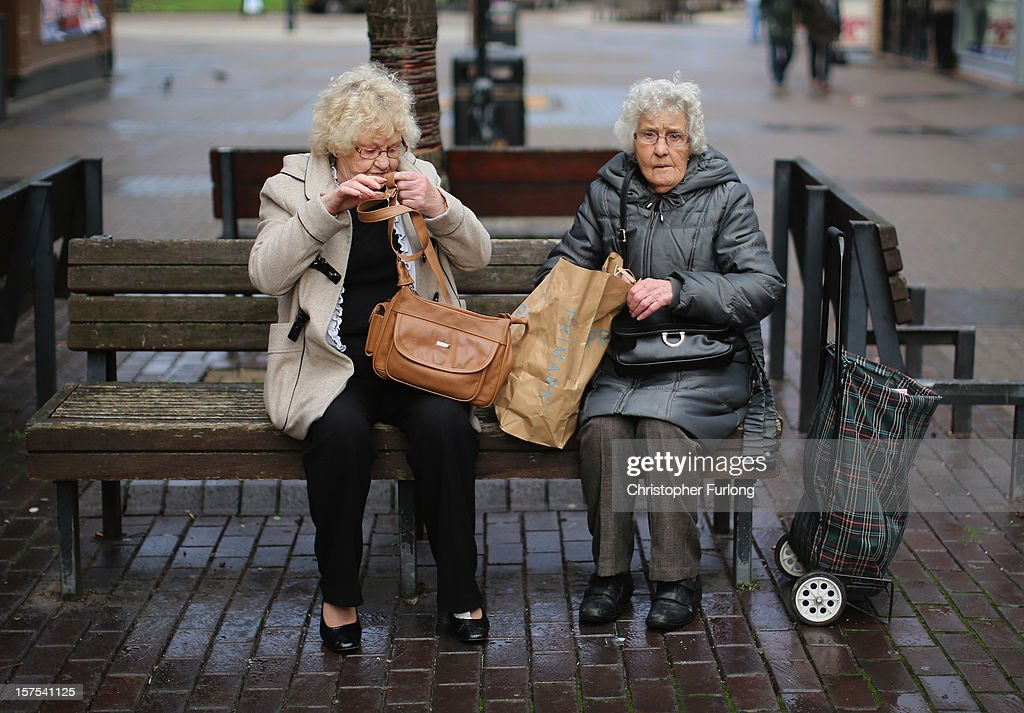 Two ladies take a rest from their Christmas shopping on December 4, 2012 in Rotherham, United Kingdom. Retailers across Britain are struggling as people wait for bigger discounts before spending for the Christmas period. The British Retail Consortium (BRC) said that it's members were in a 'state of nervousness' in the last weeks of the festive period.