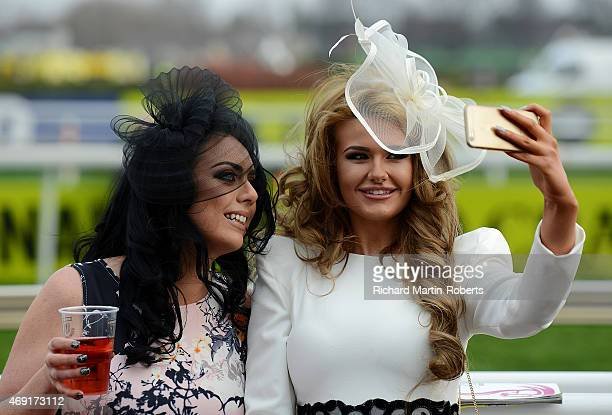 Two Ladies take a selfie on Day 2 of the Aintree races at Aintree Racecourse on April 10 2015 in Liverpool England