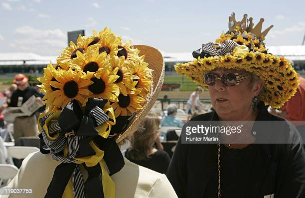 Two ladies wear 'Black Eyed Susan' hats at the 131st Preakness Stakes at Pimlico Race Track in Baltimore Maryland on Saturday May 20th 2006