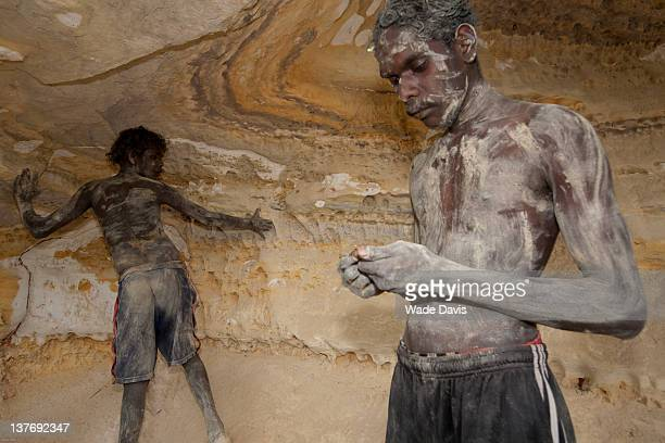 Two lads covered in protective mud Morningstar Songline Rock Wallaby Dreaming Arnhem Land Northern Territory Australia 2008