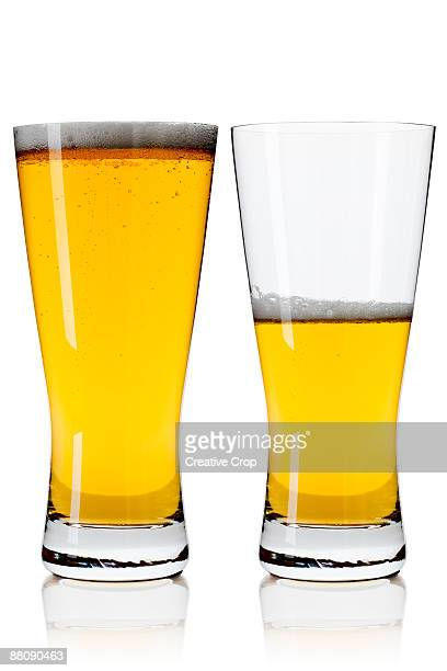 Two lager / beer glasses containing lager