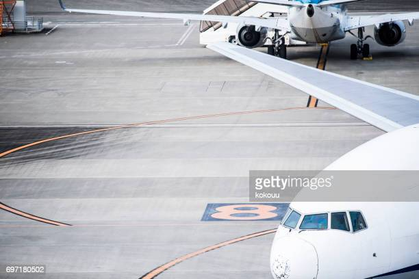 Two large planes stopped at the airport.