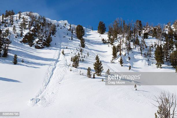 Two large sections of a cornice carved a slope in the Beehive Basin near Big Sky, Montana.